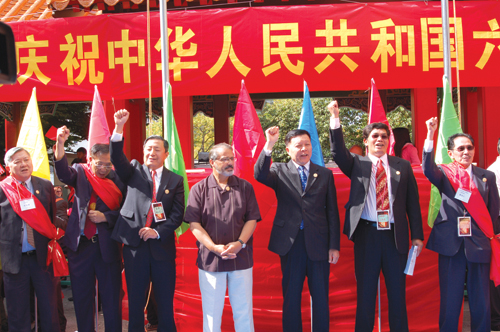 Parade attendees, from left to right: Faye Hong, Michael Chen, Stanley Xu, Lt. Gov. Brad Owen, Deputy Council General of China Xin Ping Wang, Wei Feng, and Henry Che (Photo by Rebecca Ip/NWAW)