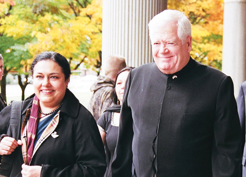 Consul General Sushimita Thomas arrives with Congressman Jim McDermott, who was wearing traditional Indian garb, at the unveiling of the Ghandi statue at Bellevue Public Library. (Photo by James Tabafunda/NWAW)