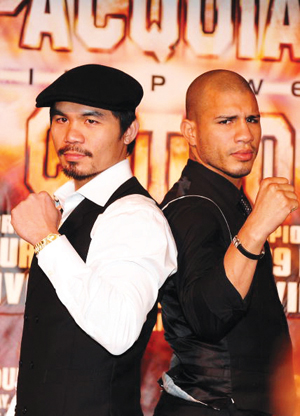 Boxer Manny Pacquiao (left) poses with his opponent, Miguel Cotto. Filipino Pacquiao won his fight against Cotto on Nov. 14.