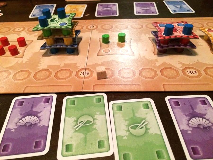 "Building towers in the two-player game ""Pagoda"" (Photo by Matthew Baldwin)"