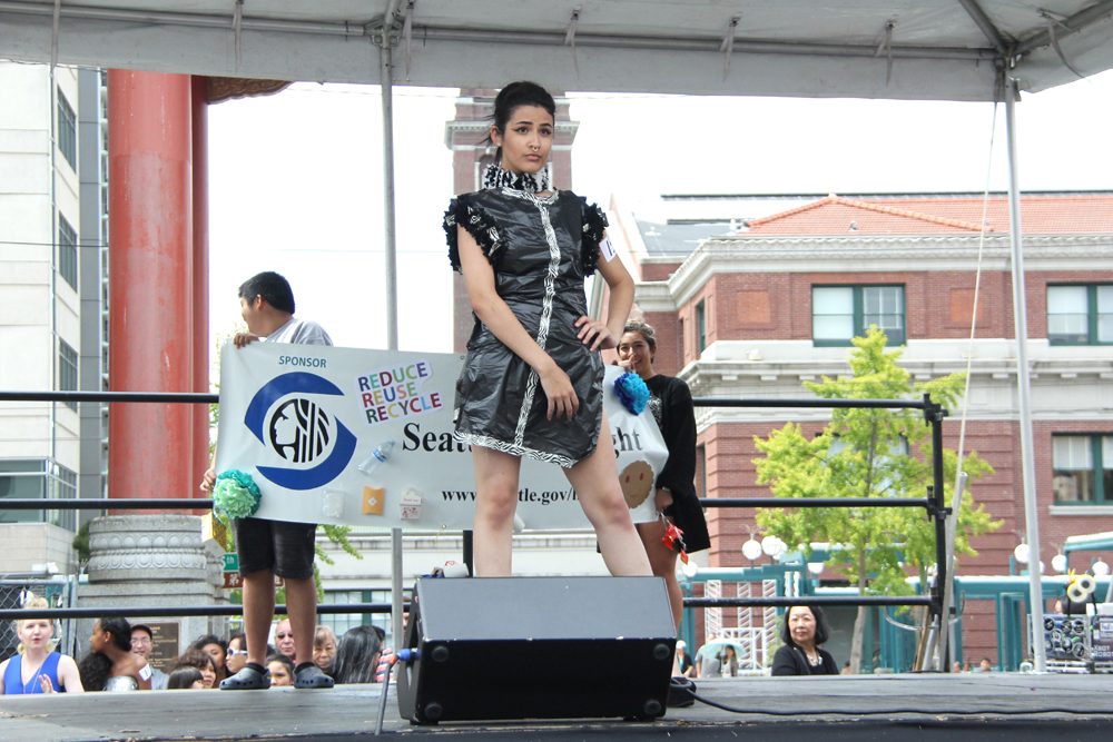 "2nd place winning design by Tony Oliver. ""Paper or Plastic"" dress. (Photo by Eugene Tagawa)"