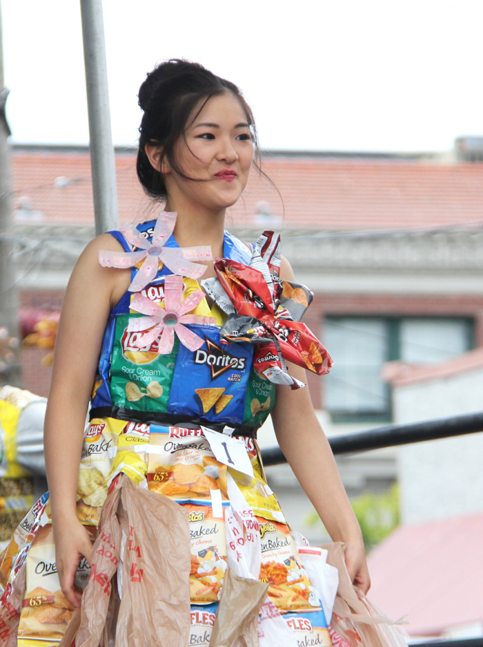 Aolin Xu, Chinese Christian Church of Tacoma, wearing a dress made of chip bags and plastic bags. (Photo by Eugene Tagawa)