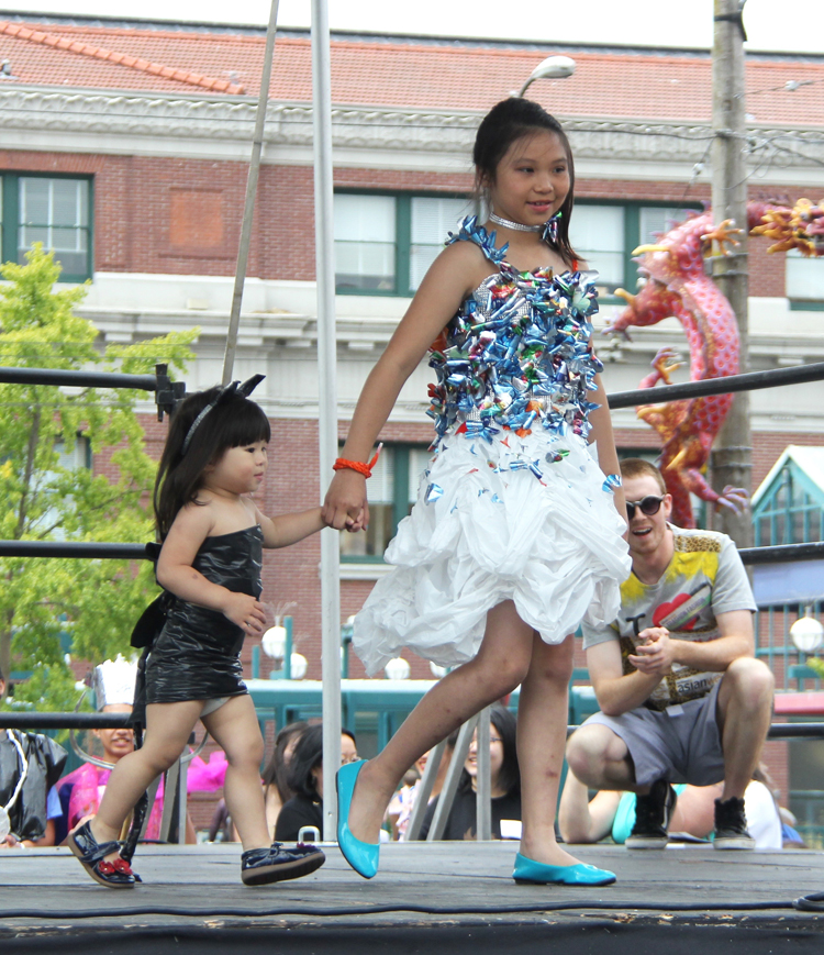 Winlyn Tam, with her little sister, modeling designs by Winlyn Tam. (Photo by Eugene Tagawa)