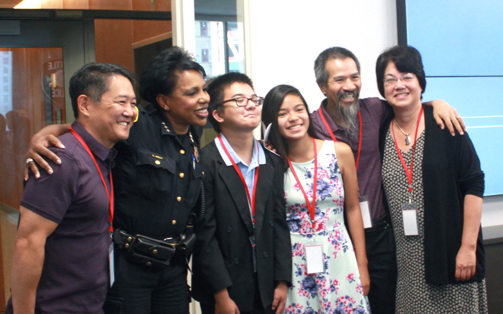 At Seattle Police Department Headquarters on Aug. 4, from left: Randy Yamanaka, SPD Deputy Chief Carmen Best, Luke Do, Christine Do, Lam Do, and Sarah Gaskins. (Photo by Stacy Nguyen/NWAW)