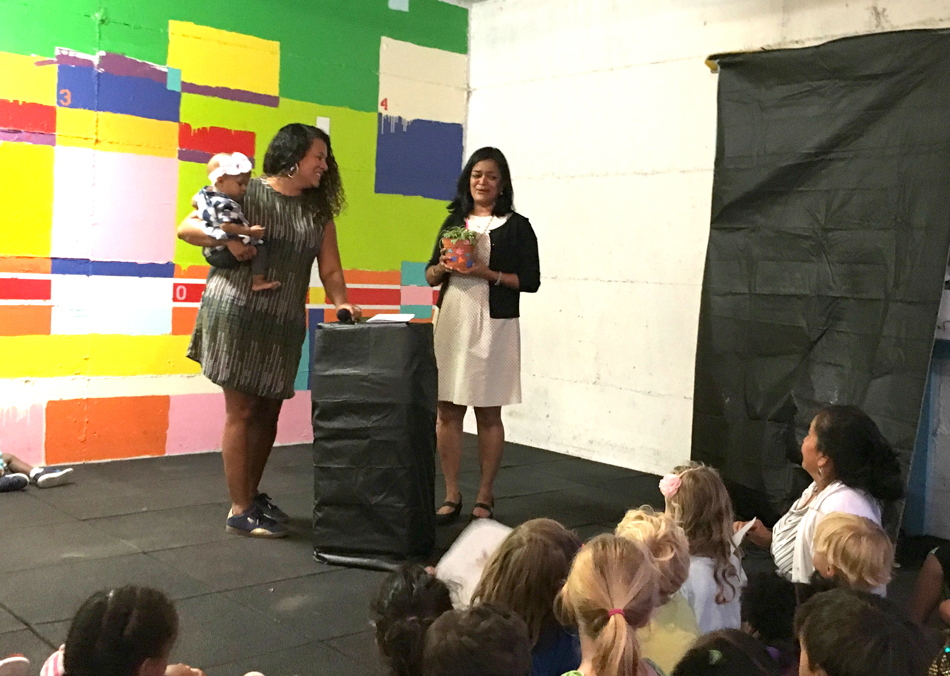 State Sen. Pramila Jayapal (right) accepts the Crayon Award from Marisol Massó Lincoln, (left) on Aug. 16. (Photo provided by Children's Alliance.)