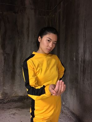 Sheenie Yip in the distinctive yellow tracksuit, similar to one worn by Bruce Lee in Game of Death. (Photo provided by the Wing Luke Museum)
