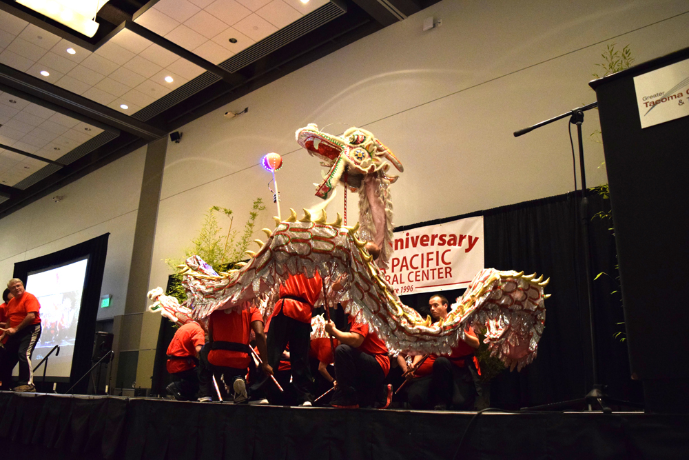 The Tacoma International Chinese Christian Church and volunteers from Bates Technical College perform a Dragon Dance.