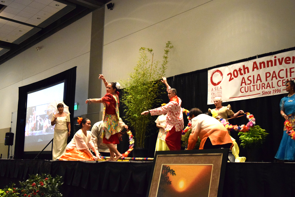 The Filipino Community Alliance Dance Group performing the traditional Tinikling dance.