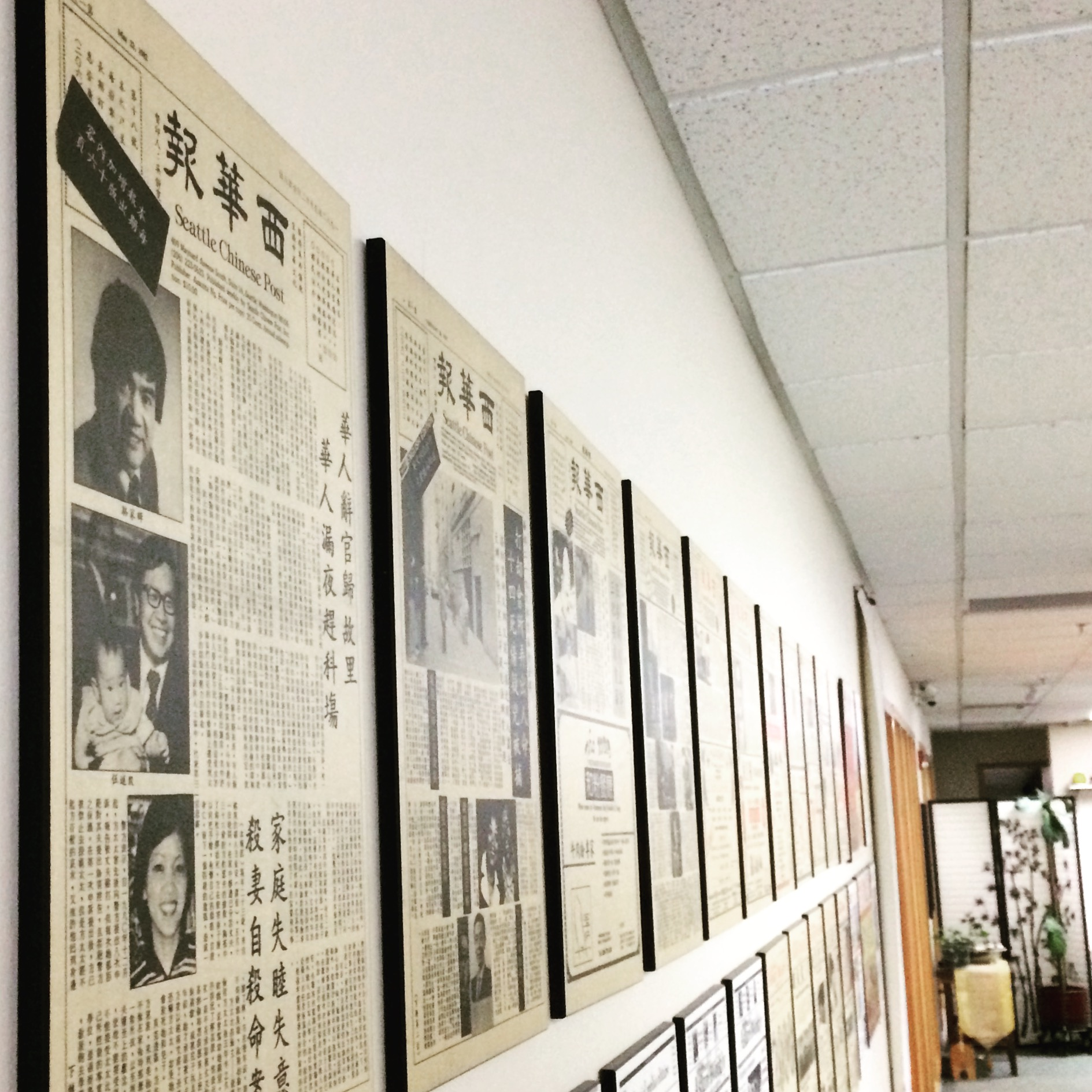 Early editions of the Seattle Chinese Post line our lobby. (Photo by Han Bui/NWAW)