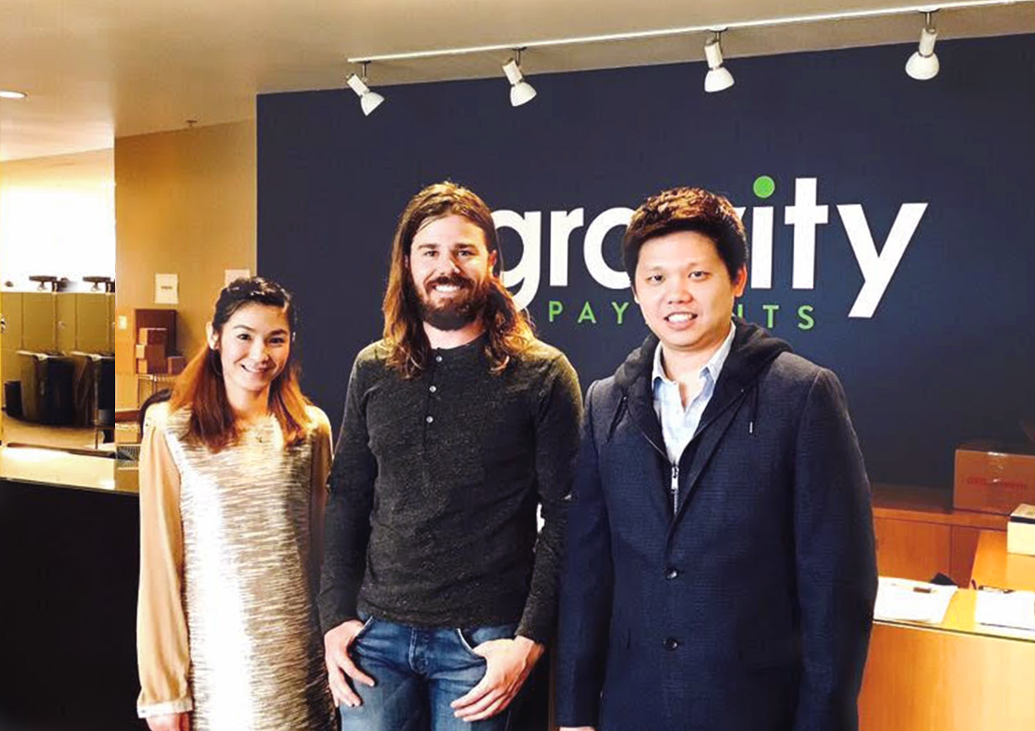 From left: Fay Suphaphian, Dan Price and Saksit Udompanit. (Photo provided by Gravity Payments)