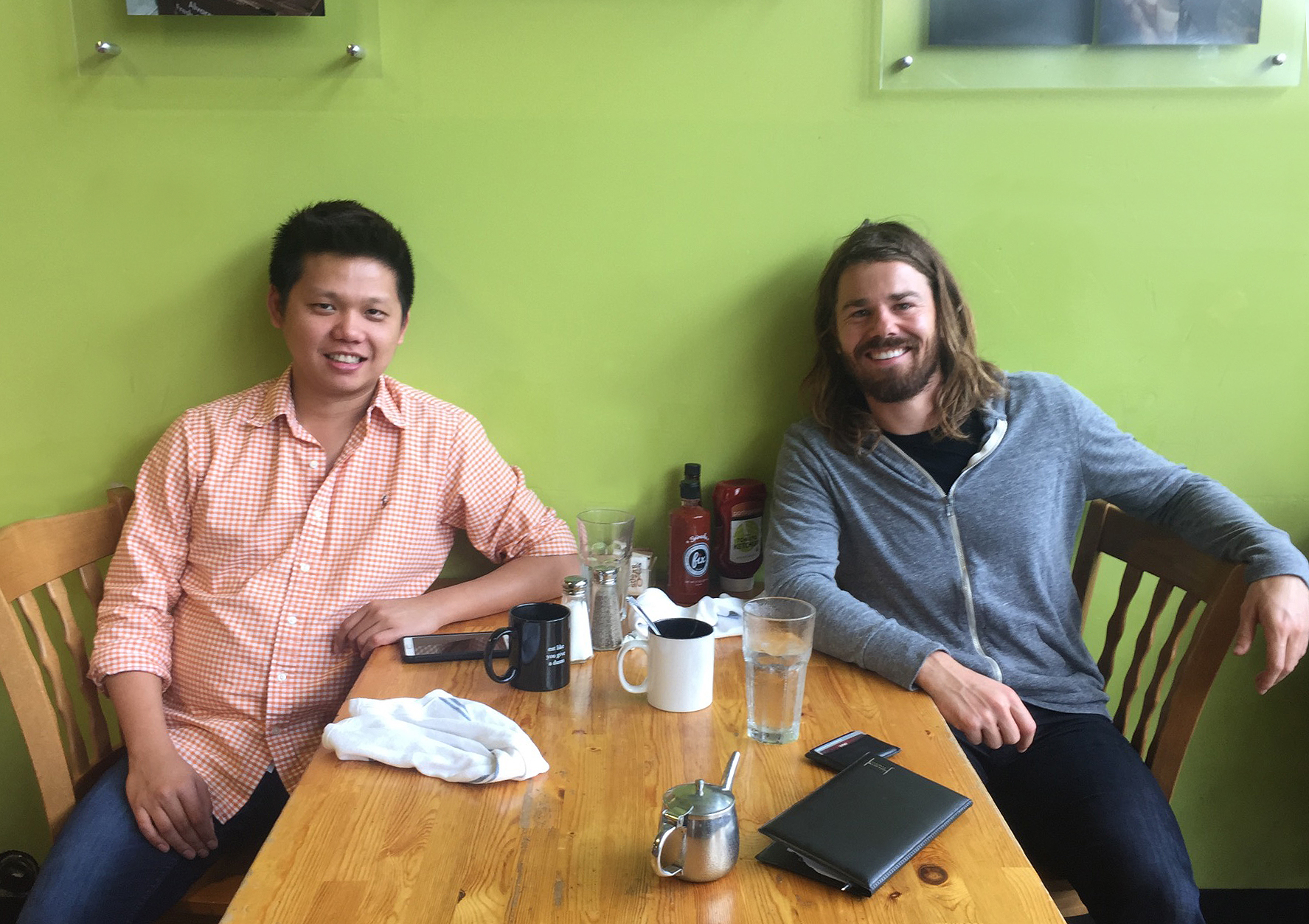 Saksit Udompanit (left) and Dan Price (right). (Photo provided by Gravity Payments)