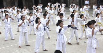 Uprooted by war, fearing troops, Myanmar girls learn karate