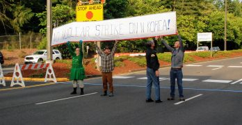Activists protest at nuclear base to de-escalate North Korea crisis