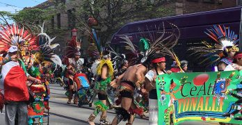 Aztec dancers from CeAtl Tonalli lead a May Day parade in Seattle